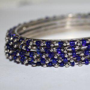 5 silver and blue bangle bracelets